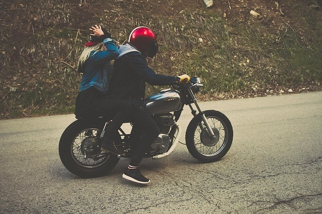 couple riding motorcycle