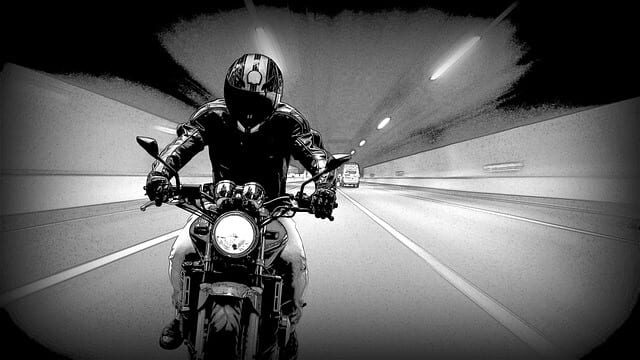 black motorcycle in tunnel